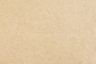 Naklejka Brown beige sheet of craft cardboard paper texture background.