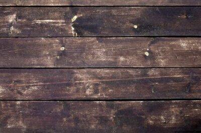 Naklejka Brown wood texture. Dark wooden planks.