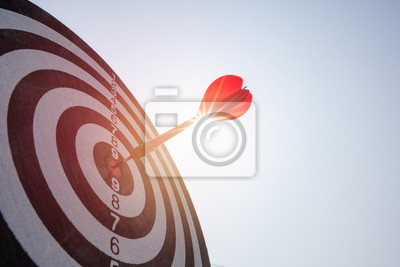 Naklejka Bullseye is a target of business. Dart is an opportunity and Dartboard is the target and goal. So both of that represent a challenge in business marketing as concept.