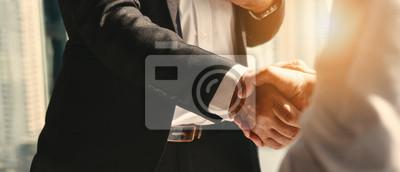Naklejka business background of businessman having handshake