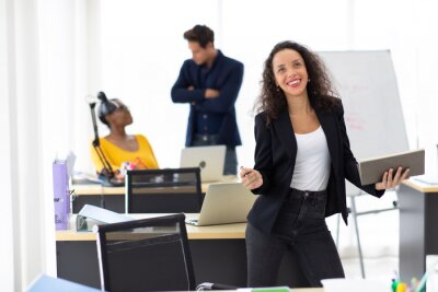 Naklejka Business corporate leadership concept. Beautiful young happy smiling professional hispanic black woman in modern home office