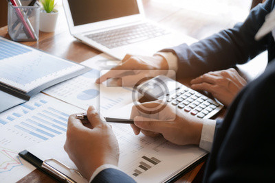 Naklejka business people working in modern office calculating financial in company, problem and solution concept.