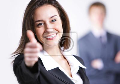 Businesswoman pokazano kciuki do góry znak, biznesmen na tle