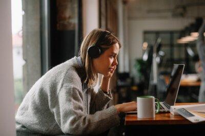 Naklejka Businesswoman working in cafe. Beautiful woman with lap top in coffee shop.