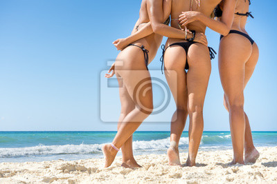 Naklejka Buttocks of young women at the beach