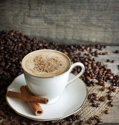 Naklejka Cappuccino i kawy rocznika martwa natura na deskach