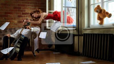 Naklejka Caucasion przystojny wiolonczela wizyta latający muse z bajki w czerwonej sukni