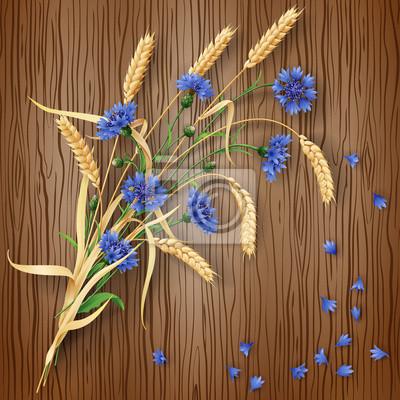 Chabry i kłosy pszenicy na tle drewna