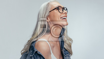 Naklejka Cheerful senior woman looking at copy space
