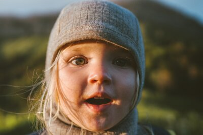 Naklejka Child face close up cute baby wearing hat 2 years old kid traveling outdoor family vacations