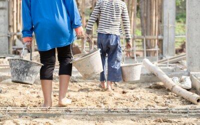 Naklejka Children working at construction site for world day against child labor concept. World Day Against Child Labour concept.