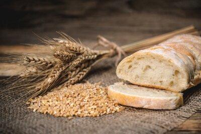 Naklejka chleb ciabatta z pszenicy na stackcloth na drewnianym rustykalnym tle