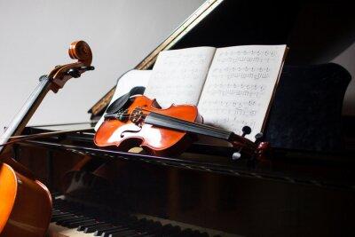 Naklejka Classical music concept: cello, violin, piano and a score