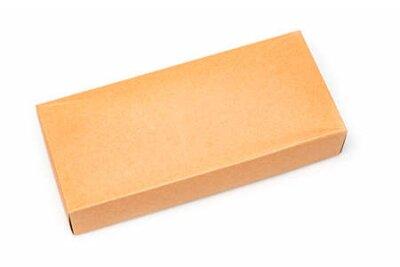Naklejka Close up Cardboard box isolated on a white background