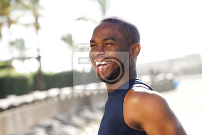 Naklejka Close up happy young black man outdoors
