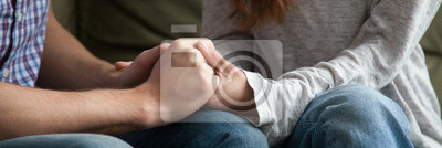 Naklejka Close up horizontal photo of couple in love holding hands loving wife supporting encouraging beloved husband show express sympathy. Understanding in relations concept banner for website header design