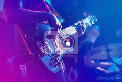 Naklejka Close up of electric guitar during rock concert