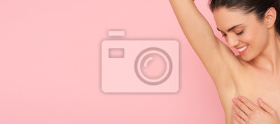 Naklejka Close up of female armpit isolated on pink background. Smooth and fresh skin after shaving.