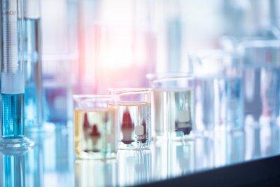 Naklejka Close-up Of Liquid In Beakers On Table At Laboratory