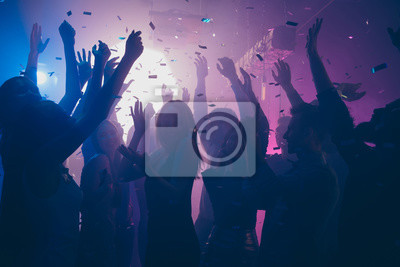 Naklejka Close up photo of many party people dancing purple lights confetti flying everywhere nightclub event hands raised up wear shiny clothes