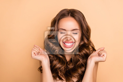 Naklejka Close-up portrait of nice attractive lovely gorgeous girlish excited cheerful cheery dreamy lucky wavy-haired girl enjoying expecting pleasure isolated on beige pastel color background
