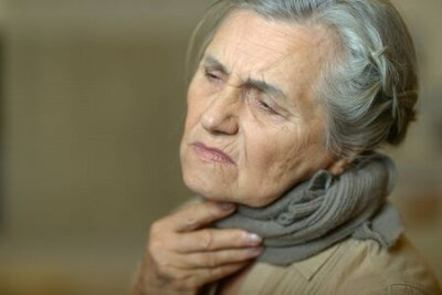 Naklejka Close up portrait of sad ill senior woman