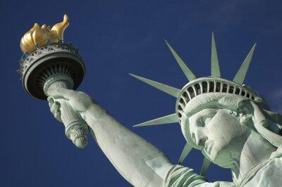 Naklejka Close-up Portret Statua Wolności Torch Bright Blue Sky