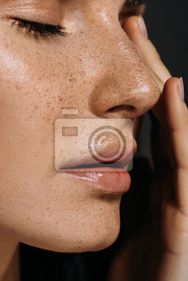 Naklejka close up view of tender woman with freckles on face isolated on grey