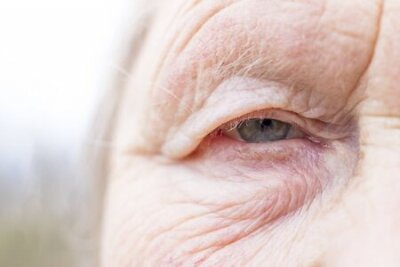 Naklejka Close-up. Woman aged. Eye in the center of the frame. The pupil has soft focus, the concept of poor eyesight, everything is blurry.