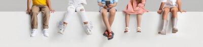 Naklejka Collage of five children legs wearing various footwear