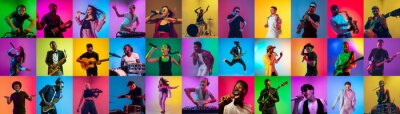 Naklejka Collage of portraits of 21 young emotional talented musicians on multicolored background in neon light. Concept of human emotions, facial expression, sales. Playing guitar, singing, dancing, jumping.