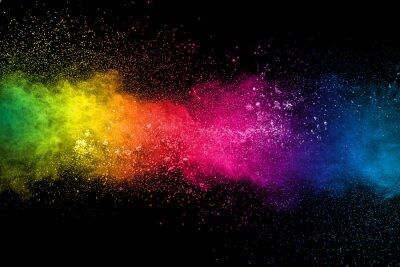 Naklejka Colorful background of pastel powder explosion.Multi colored dust splash on black background.Painted Holi.