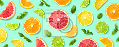 Naklejka Colorful pattern of citrus fruit slices and mint leaves