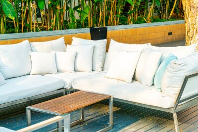 Naklejka comfortable pillows on outdoor patio chair and table