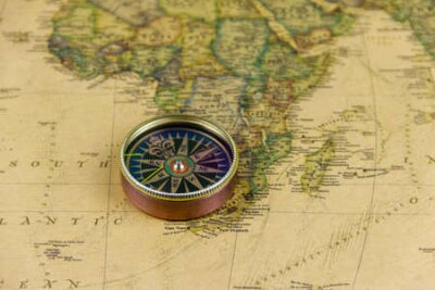 Naklejka Compass on a vintage world map. Retro style