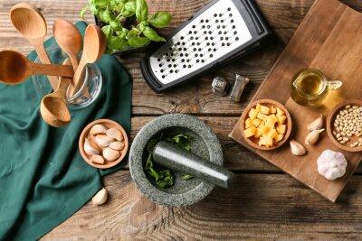 Naklejka Composition with tasty pesto sauce on wooden background