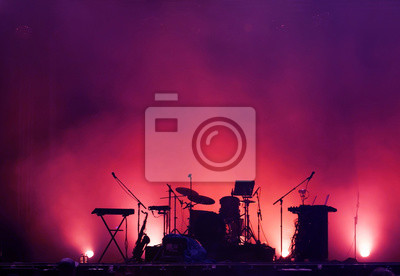 Naklejka concert stage on rock festival, music instruments silhouettes, colorful background with copy space