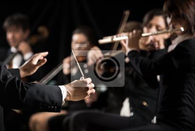 Naklejka Conductor directing symphony orchestra