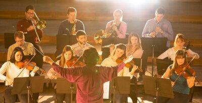 Naklejka Conductor leading orchestra