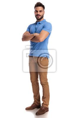 Naklejka confident man standing with his hands crossed