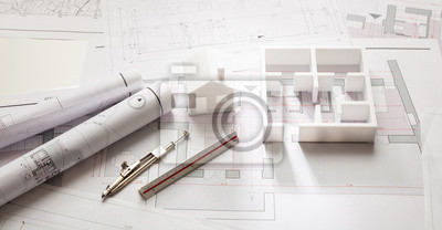 Naklejka Construction concept. Residential building drawings and architectural model,