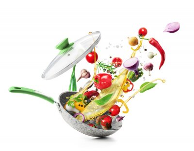 Naklejka Cooking concept. Vegetables are flying out of the pan isolated on white background. Healthy food.