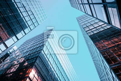 Naklejka Corporate office building facade and sky - business concept -