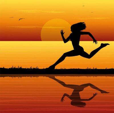 Naklejka Correre al tramonto sul mare