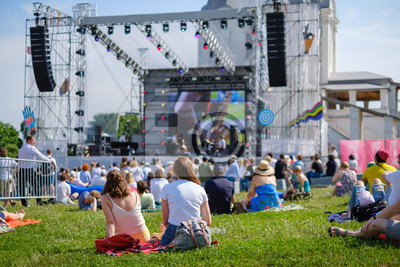 Naklejka Couple is watching concert at open air music festival