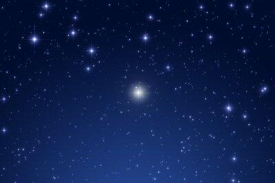 Naklejka Cristmas gwiazda na ciemnym niebie.