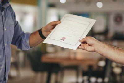 Naklejka Cropped Hands Of Businessman Holding Certificate