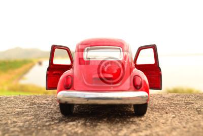 Naklejka Czerwony samochodzik parku na drodze w Riverside