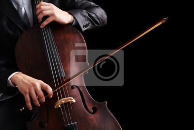 Naklejka Człowiek gra na wiolonczeli na ciemnym tle