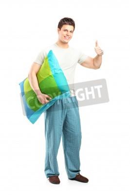 Naklejka Człowiek w piżamie dając kciuk w górę na białym tle